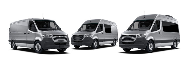 Three silver-gray Freightliner vans