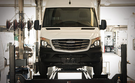 White Sprinter Van Inside Dealership Shop