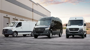 Two white Sprinter Cargo Vans with one black Cargo Van in the middle
