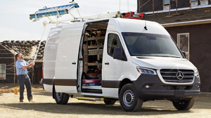 Man working out of the back of a white Sprinter Cargo Van