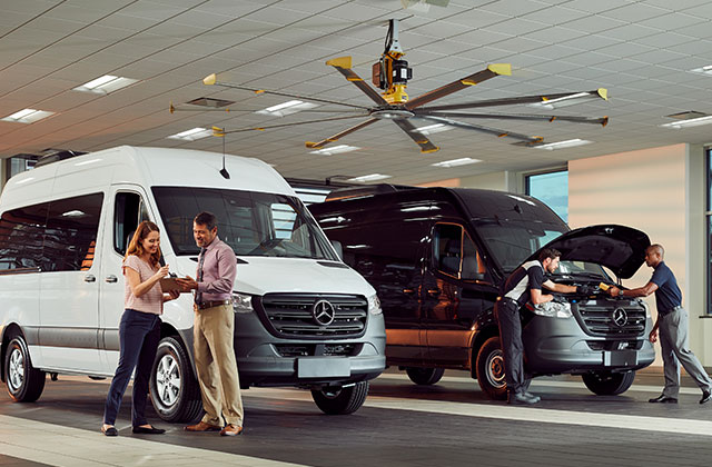 Mercedes-Benz Vans - Two People Standing Next to Passenger Vans