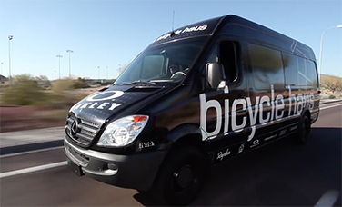 """A black Sprinter Crew Van with a """"Bicycle Haus"""" decal"""