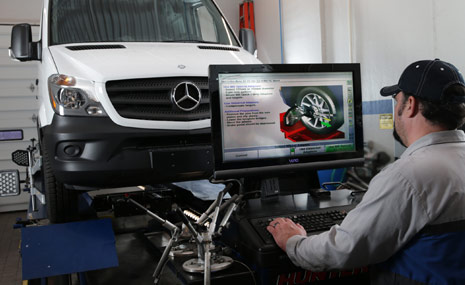 Man Running Diagnostics on Van