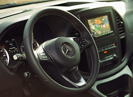 Driver's view of the steering wheel and center console of the Metris Getaway van.