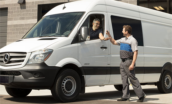 Men Standing Near A Mercedes-Benz Sprinter Van