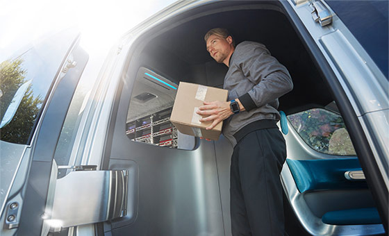 Man Holding a Package Inside a Sprinter Van