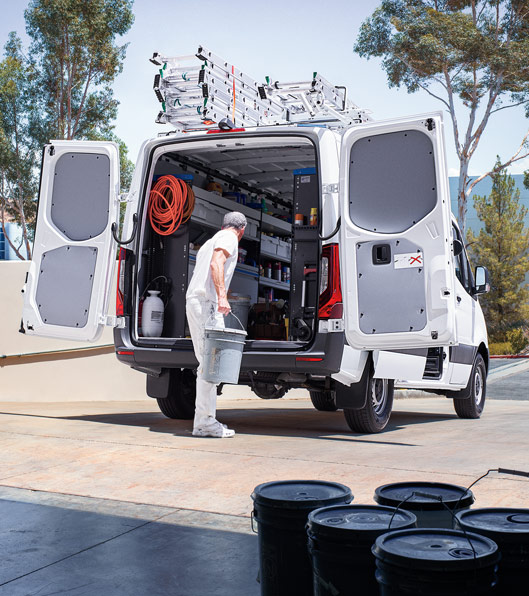 A worker walking in the back of a Sprinter Cargo Van