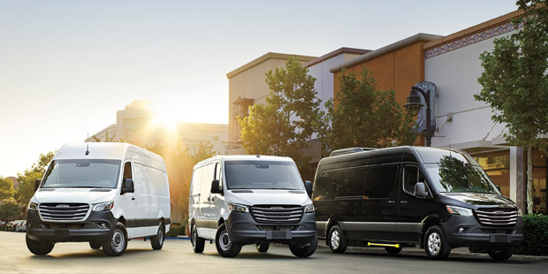 Four different Mercedes-Benz van models parked at a business center.